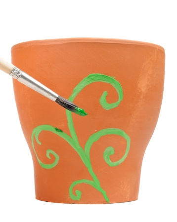 flower pot: Brush Painting Ornament on Clay Flower Pot Stock Photo