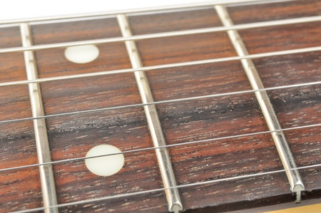 Electric Guitar Fingerboard (Fretboard) with Strings Close-up photo