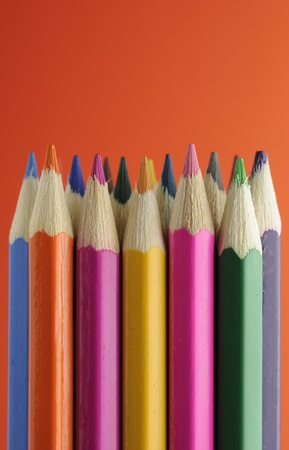 Colored Pencils on Orange Background photo
