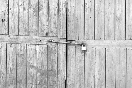Old Wooden Gates with Padlock photo