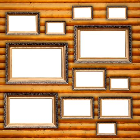 Blank Picture Frames on Wooden Wall photo