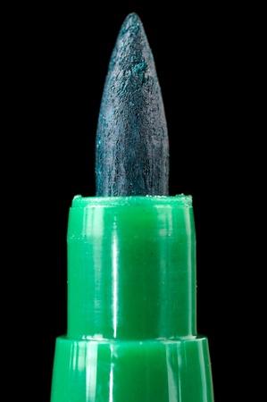 felt tip: Green Felt Tip Pen Close-Up on Black Background Stock Photo