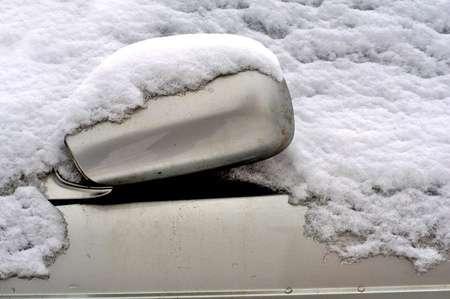 Car Covered in Snow in Winter photo