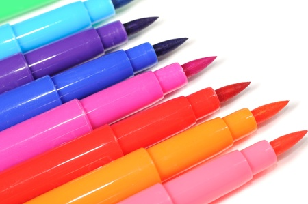 Multicolored Felt Tip Pens on White Background photo