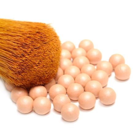 Face Powder Pearls  Ball-Powder  and Make-up Brush on White Background photo