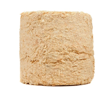Compressed Sawdust Fire Log Isolated on White Background photo