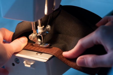 Seamstress Sewing on Velcro Hook-And-Loop Fastener Stock Photo