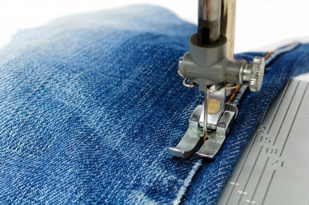 textile machine: Foot of Sewing Machine on Jeans Fabric
