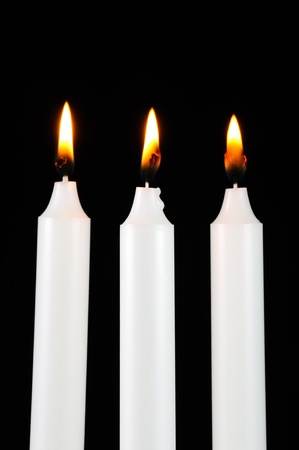 Burning Candles in the Dark photo