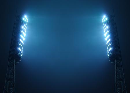 cancha de basquetbol: Los reflectores del estadio contra el oscuro cielo nocturno con copia espacio