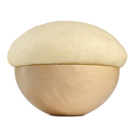 Rising Yeast Dough in Wooden Bowl Isolated on White Background Standard-Bild