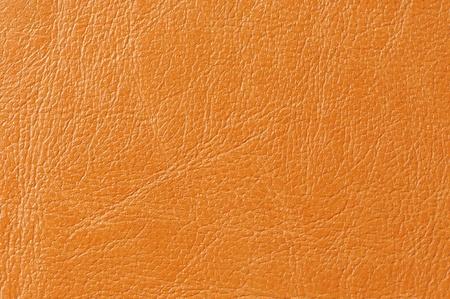 bumped: Orange Faux Leather Background Texture