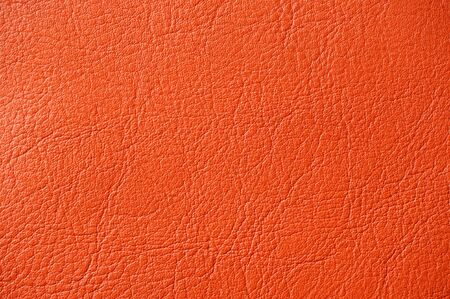 Vermilion Red Artificial Leather Background Texture Close-Up photo