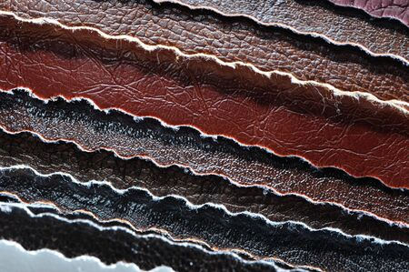 skin color: Stack of Artificial Leather Samples Close-Up Stock Photo