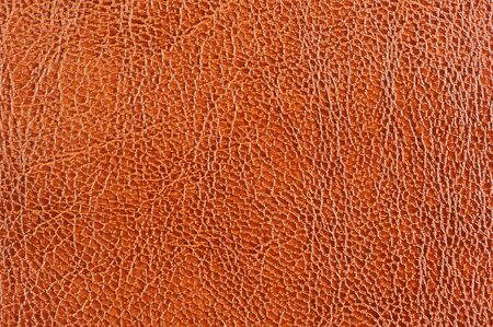 leatherette: Brown Glossy Patterned Leather Background Texture