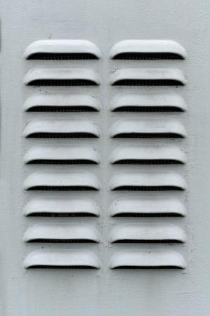 louvered: A gray metal ventilation louver with horizontal slats