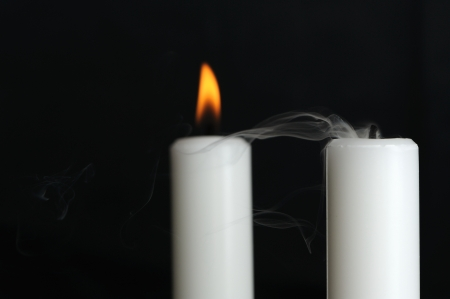 Burning and Blown Out Candle with Smoke photo