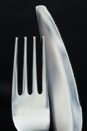 Fork and Table Knife on Black Background Stock Photo - 18684322