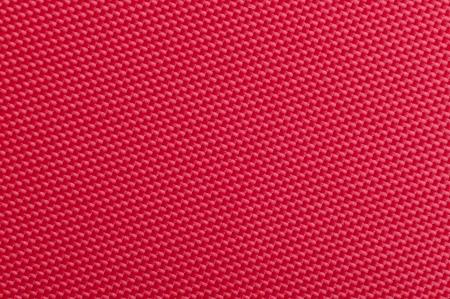 tela algodon: Un primer plano de la textura de tela roja Foto de archivo