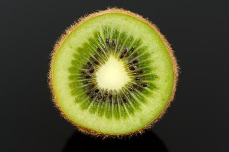 produce sections: Kiwi Fruit Cross Section on Black Background