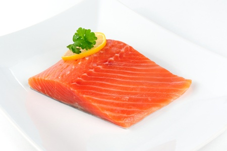Salmon Fillet with Lemon and Parsley on Plate photo