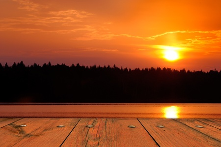 View of Sun Setting Behind Black Forest from Wooden Deck photo