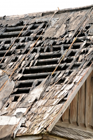 Broken Roof of Old Abandoned Wooden House photo