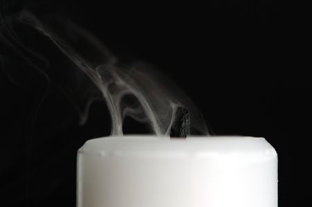 Candle with Smoke on Black Background