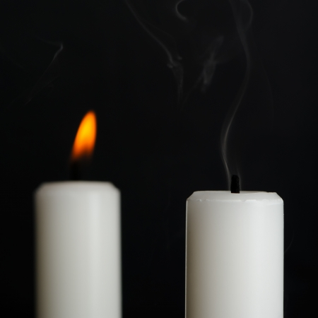 blow out: Candle with Smoke and Burning Candle