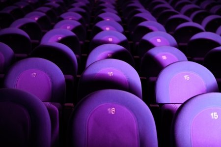 Empty Movie Theater with Purple Seats photo