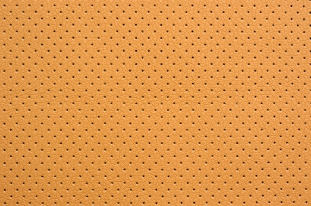 leatherette: Yellow Perforated Artificial Leather Background Texture