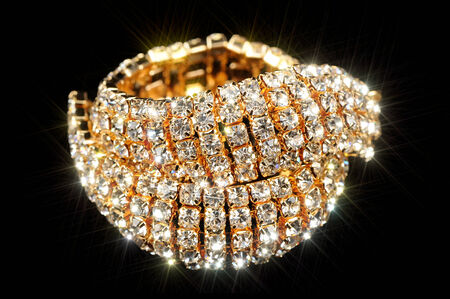 Gold Bracelet with Cubic Zirconia on Black Background photo