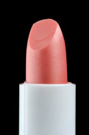 Pink Lip Care Stick on Black Background photo