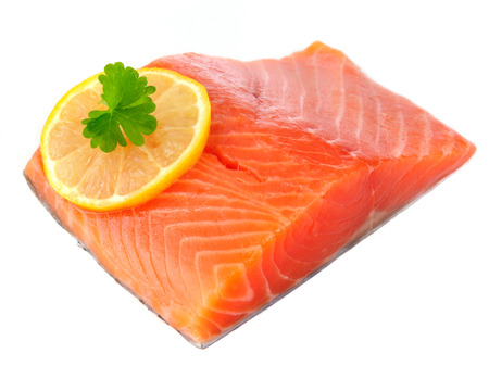 Salmon Fillet with Lemon Isolated on White Background photo