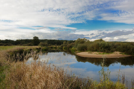 bullrush: Landscape with River and Clouds Stock Photo