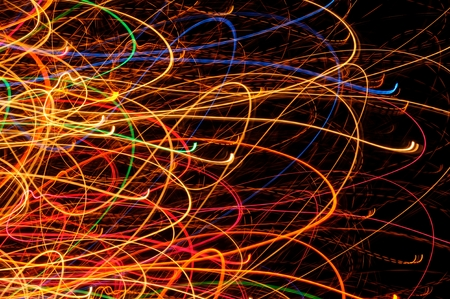 Abstract Bright Multicolored Glowing Lines and Curves on Black photo