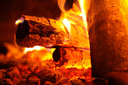 wood stove: Burning Wood in Fireplace Stock Photo