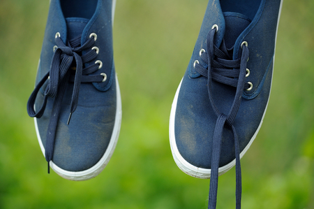 plimsoll: Dirty Blue Sneakers on Clothes Line