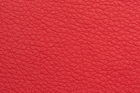 Scarlet Red Artificial Leather Background Texture Close-Up photo