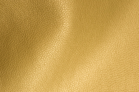 Golden Glossy Artificial Leather Background Texture Close-Up