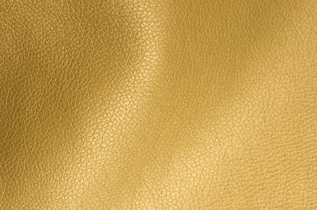 dorado: Textura de oro brillante artificial Fondo de cuero Primer plano Foto de archivo