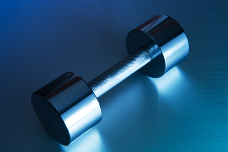 Metal Dumbbell on Metal Background