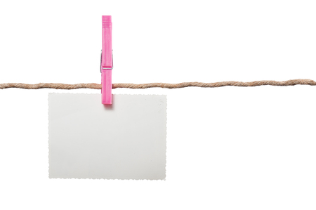 recollections: Blank Photo on Rope with Clothespin on White Background Stock Photo