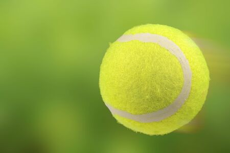 chartreuse: Lawn Tennis Ball in Motion on Green Background