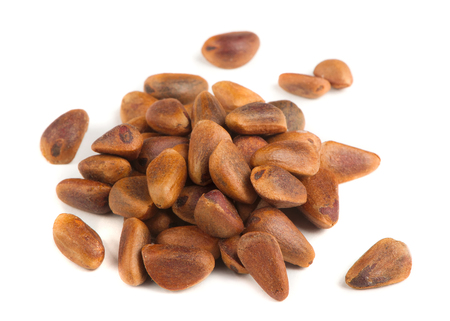 pine kernels: Pine Nuts Isolated on White Background Stock Photo