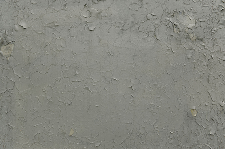 crackles: Grey Paint Peeling Off the Wall