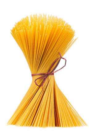tied in: Raw Spaghetti Tied in Bundle Isolated on White Background
