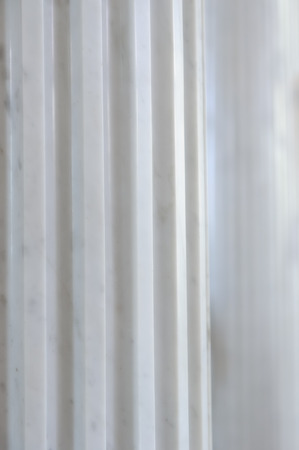 column: A close-up of an antique white marble fluted column Stock Photo
