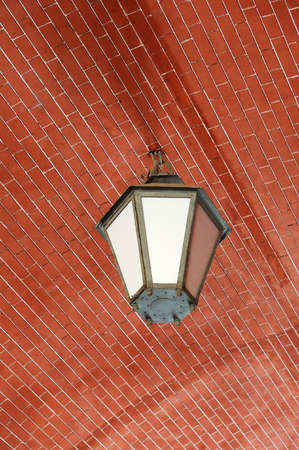 electric fixture: A vintage outdoor lantern in an arch