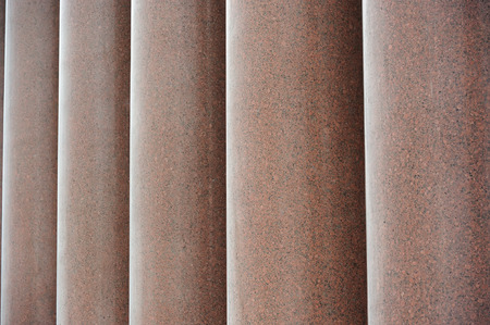 greece granite: A row of massive red granite columns Stock Photo